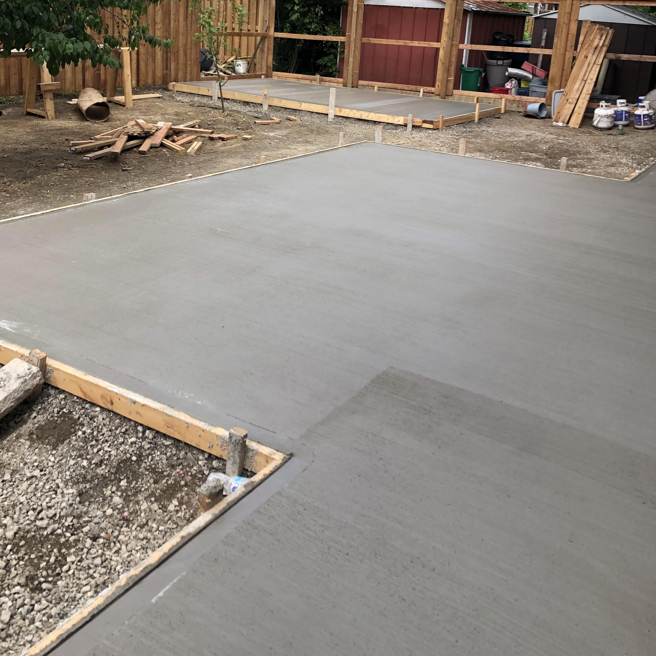 CONCRETE BACK PATIO WITH SHED FOUNDATION